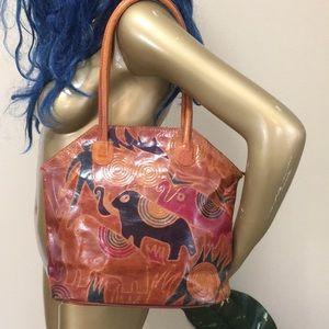 Elephant designed leather bag